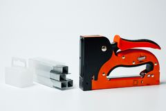 Stapler household, new, orange, reliable with staples royalty free stock photography