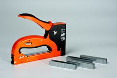 Stapler household, new, orange, reliable with staples stock photo