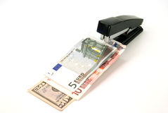 Stapler and money Royalty Free Stock Photo