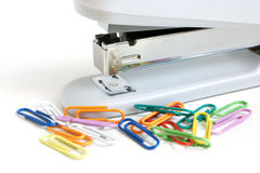 Stapler and multicolored paper clips Royalty Free Stock Photography