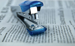 Stapler on Newspaper Stock Image