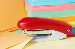 Stapler with note paper. Stapler with multicolor sheets of note paper Royalty Free Stock Image