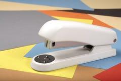 Stapler. Office stapler on a colour paper stock image