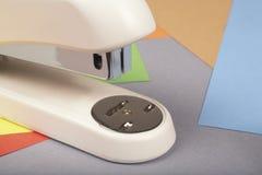 Stapler. Office stapler on a colour paper Royalty Free Stock Photos