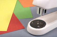 Stapler. Office stapler on a colour paper. Horizontal position stock photography
