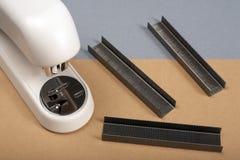 Stapler. Office stapler on a colour paper. Horizontal position Royalty Free Stock Images