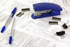 Stapler and pen on documents stock image