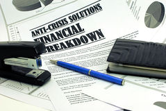 Stapler, purse and pen upon newspaper article abo Royalty Free Stock Photo