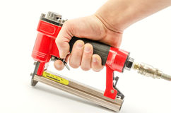 Stapler. Red stapler pneumatic hand tool Stock Images