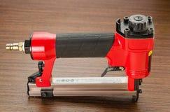 Stapler. Red stapler pneumatic hand tool Royalty Free Stock Image