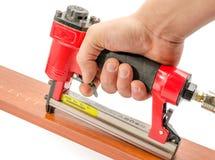 Stapler. Red stapler pneumatic hand tool stock image