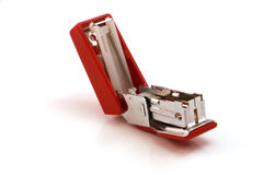 Stapler. Red silver stapler to staple the documents or papers stock image