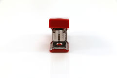 Stapler. Red silver stapler to staple the documents or papers royalty free stock photography