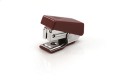 Stapler. Red silver stapler to staple the documents or papers stock photography