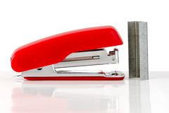 Stapler. The red stapler with staples isolated on a white background royalty free stock images