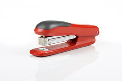 Stapler. Red stapler on white background Stock Photos
