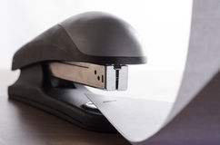 Stapler. And sealed with a paper staple royalty free stock images