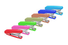 Stapler seven color isolated on white Royalty Free Stock Image
