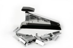 Stapler on silver chrome and black over white royalty free stock photography