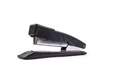 Stapler. Staple the paper with paper clips Royalty Free Stock Photography