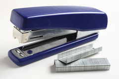 Stapler and staples over white Stock Photography