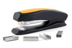 Stapler and staples to him Royalty Free Stock Image
