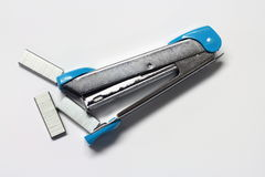 Stapler and staples. Top view, Blue stapler and staples on white background stock photo