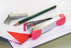 Stapler with staples wires on white paper Stock Photography