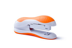 Stapler on white background. Side close-up view of stapler. Orange stapler isolated. Office equipment for paperwork Stock Images