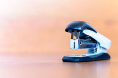Stapler on wooden background. One stapler on wooden background Stock Photography