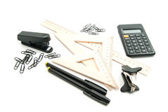 Stapler, wooden ruler and other stationery. On white stock photo