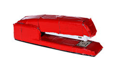 Stapler with wrapped with red tape Stock Image
