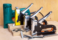 Staplers electrical and manual mechanical - for repair work in the house and on furniture, and brackets Stock Images