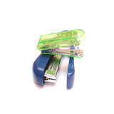 Staplers isolated on white. A large blue and a smaller green stapler on white background royalty free stock photos