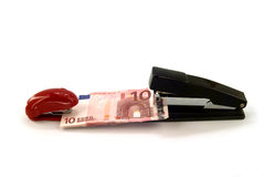 Staplers and money. Two staplers hold the money Royalty Free Stock Photos