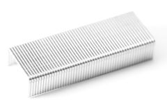 Staples. A line of unused staples on white Royalty Free Stock Photo