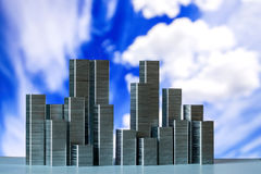 Staples arranged to form city skyline on a blue sky with white c Stock Image