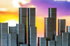 Staples arranged to form city skyline on a sunset background Royalty Free Stock Photography