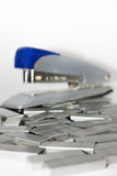 Staples in closeup view with stapler Royalty Free Stock Photos