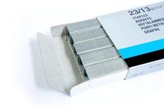 Staples empilha na caixa Foto de Stock