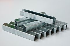 Staples made of metal for household staplers royalty free stock photography