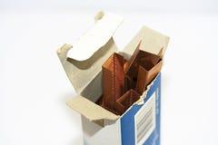Staples na caixa azul fotografia de stock