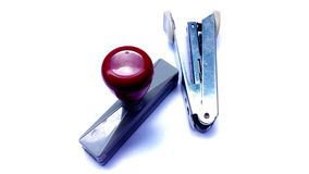 Staples and rubber stamps are basic equipment . stock illustration