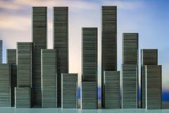 Staples schikte om stadshorizon op een zonsondergangachtergrond te vormen Stock Fotografie