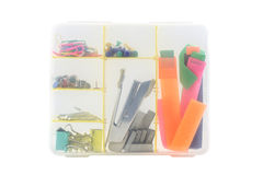 staples and stationery buttons and office equipment in a box Royalty Free Stock Photo