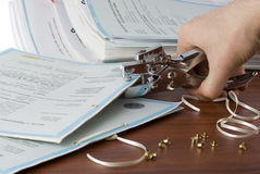 Stapling. A stapler, accessories and documents on a wooden desk Stock Images