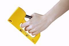 Stapling. Girl using a stapler Royalty Free Stock Images