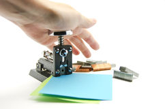 Stapling sheets of paper. With  a retro stapler Stock Photo