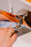 Stapling tissue. Cloth or fabric stitched sewing machine Royalty Free Stock Photos