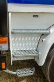 Stappen op de cabine van een vrachtwagen stock afbeelding